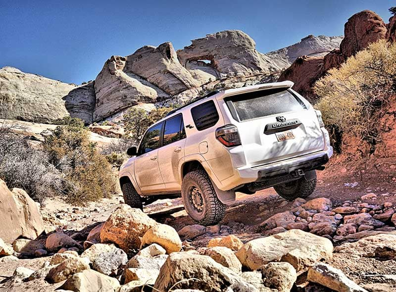 Water Pocket Adventures SUV on a 4x4 trail in the Utah desert