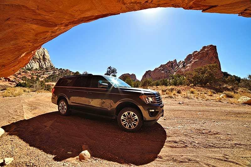 Water Pocket Adventures SUV on a dirt road in the Utah desert