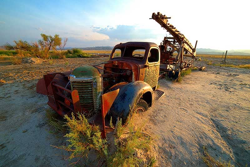 Abandoned and rusted truck stuck in the desert