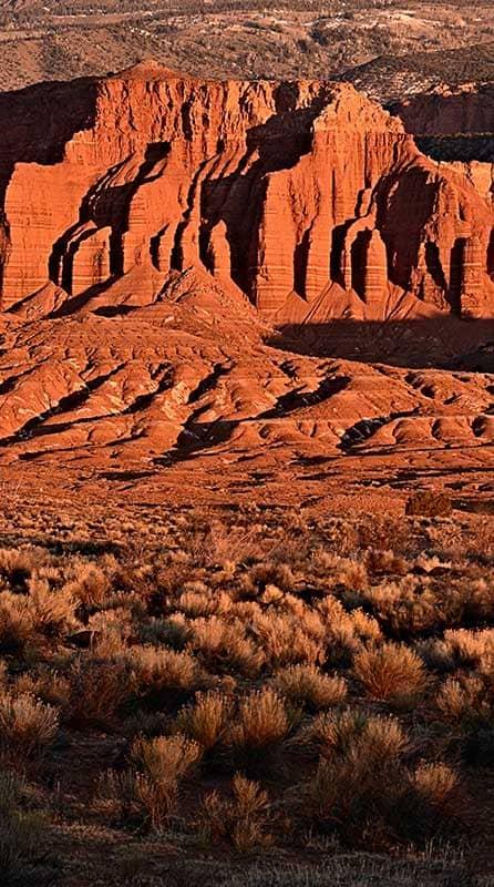 Sandstone cliffs lit up at sunset