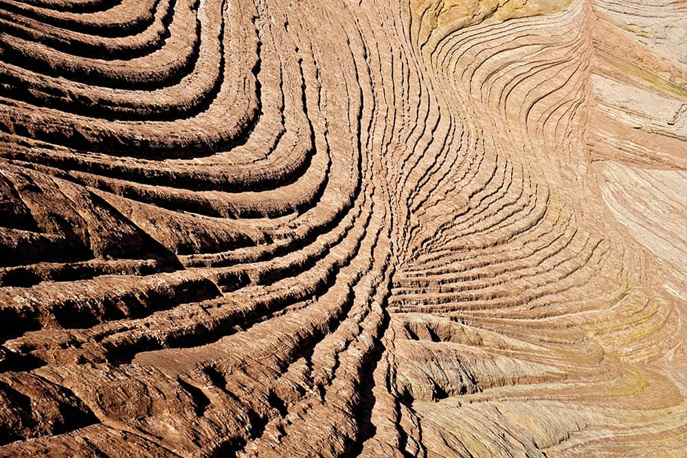 Detail image of layers of sandstone swirling and curving.